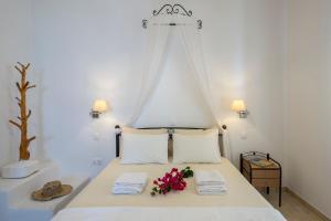 Ένα ή περισσότερα κρεβάτια σε δωμάτιο στο Anemonisia Deluxe Apartments