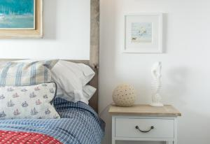 A bed or beds in a room at Creagle, Sennen Cove