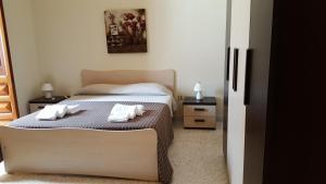 Letto o letti in una camera di Appartamenti Emblema Mancaversa