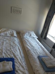 En eller flere senger på et rom på Trolltunga Apartments