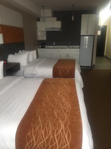 A bed or beds in a room at Southfort Inn