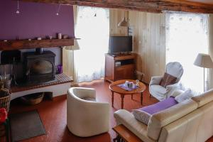 Coin salon dans l'établissement Maison du Coué Pyrénées Mourtis