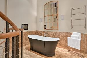 A bathroom at Augustine, a Luxury Collection Hotel, Prague