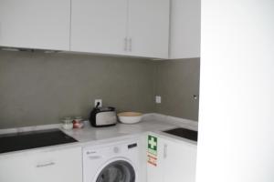A kitchen or kitchenette at Vila Prata 10