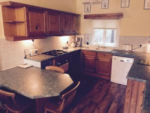 A kitchen or kitchenette at The Central Guesthouse
