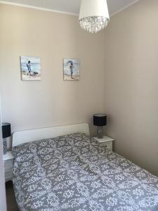 Łóżko lub łóżka w pokoju w obiekcie Balticsand Apartament
