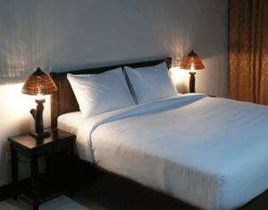 A bed or beds in a room at Daosavanh Resort & Spa Hotel