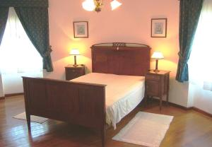 A bed or beds in a room at Villa Moino