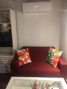 Zona de estar de Apartamentos El Greco