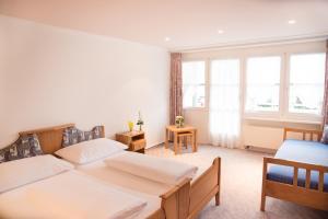 Ein Bett oder Betten in einem Zimmer der Unterkunft Hotel Toggenburgerhof