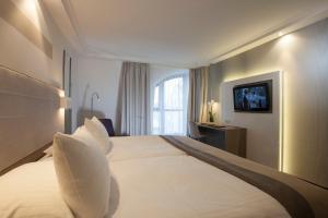 Cama o camas de una habitación en Hotel Erzgiesserei Europe