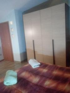 A bed or beds in a room at 69 Via Luigi Angrisani-casa di zeus