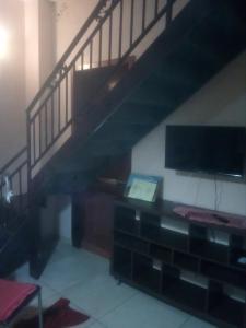 A television and/or entertainment center at 69 Via Luigi Angrisani-casa di zeus