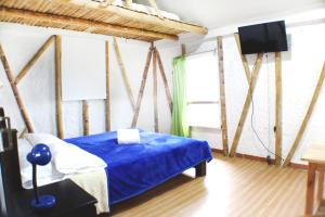 A bed or beds in a room at Eco Lodge La Juanita
