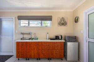 A kitchen or kitchenette at Pro Moni's Guesthouse