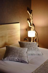 A bed or beds in a room at Villa Les Bains
