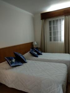 Uma cama ou camas num quarto em ROSÉLIO REIS - ALOJAMENTO TURÍSTICO