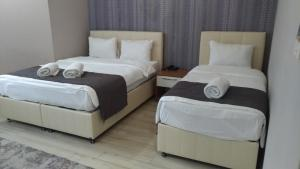 A bed or beds in a room at Grand Dost Hotel