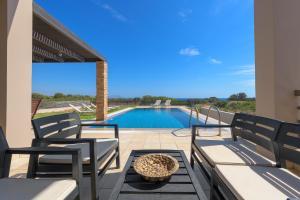 Πισίνα στο ή κοντά στο Blue Wave Villas
