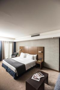 A bed or beds in a room at Anatolia Hotel