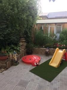 Children's play area at Guest house Sibiriachka