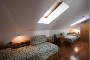 Letto o letti in una camera di Residence Villa Odescalchi