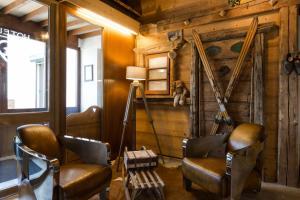 Coin salon dans l'établissement The Originals Annemasse Sud - Porte de Genève