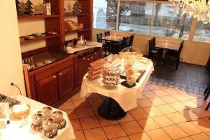 Ein Restaurant oder anderes Speiselokal in der Unterkunft Martinshof