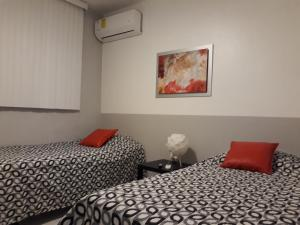 A bed or beds in a room at Isla Verde Aptm
