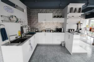 A kitchen or kitchenette at The Moon Hostel Huahin