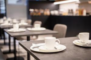 Een restaurant of ander eetgelegenheid bij Hotel Carnac