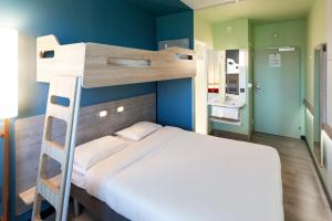 A bunk bed or bunk beds in a room at ibis budget Genève Aéroport