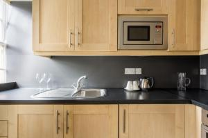 A kitchen or kitchenette at Dolphin House Serviced Apartments