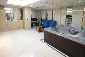 A kitchen or kitchenette at Hotel The Grang Nampo-formerly YTT