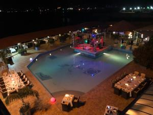 A view of the pool at Hotel Le Petit Bateau or nearby