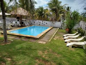 The swimming pool at or near Caponga Casa 4/4 Ceará