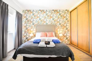 A bed or beds in a room at Vila Vale Mouro by OCvillas
