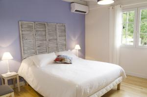 A bed or beds in a room at Maison Laia