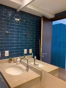A bathroom at Beach Class Executive Apartamento