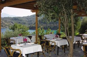 A restaurant or other place to eat at Kerveli Village Hotel