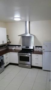 A kitchen or kitchenette at Campeche Villa