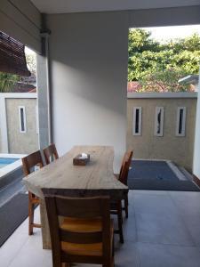 A balcony or terrace at The Surya Kuta Villa