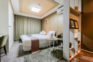 A bed or beds in a room at Residence Hotel Line
