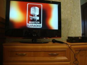 Телевизор и/или развлекательный центр в Guest house KOROBICINO