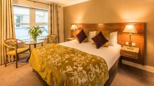 A bed or beds in a room at Clew Bay Hotel