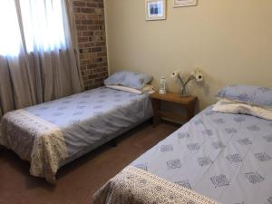 A bed or beds in a room at Bronte Court No 3 at South West Rocks