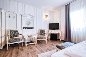 Ein Sitzbereich in der Unterkunft Central Hotel am Königshof
