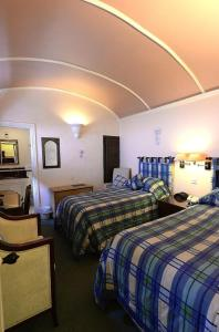 A bed or beds in a room at Meryan House Hotel