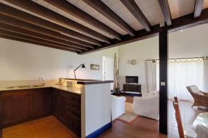 A kitchen or kitchenette at Casas do Monte