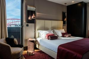 A bed or beds in a room at Upon Lisbon Prime Residences